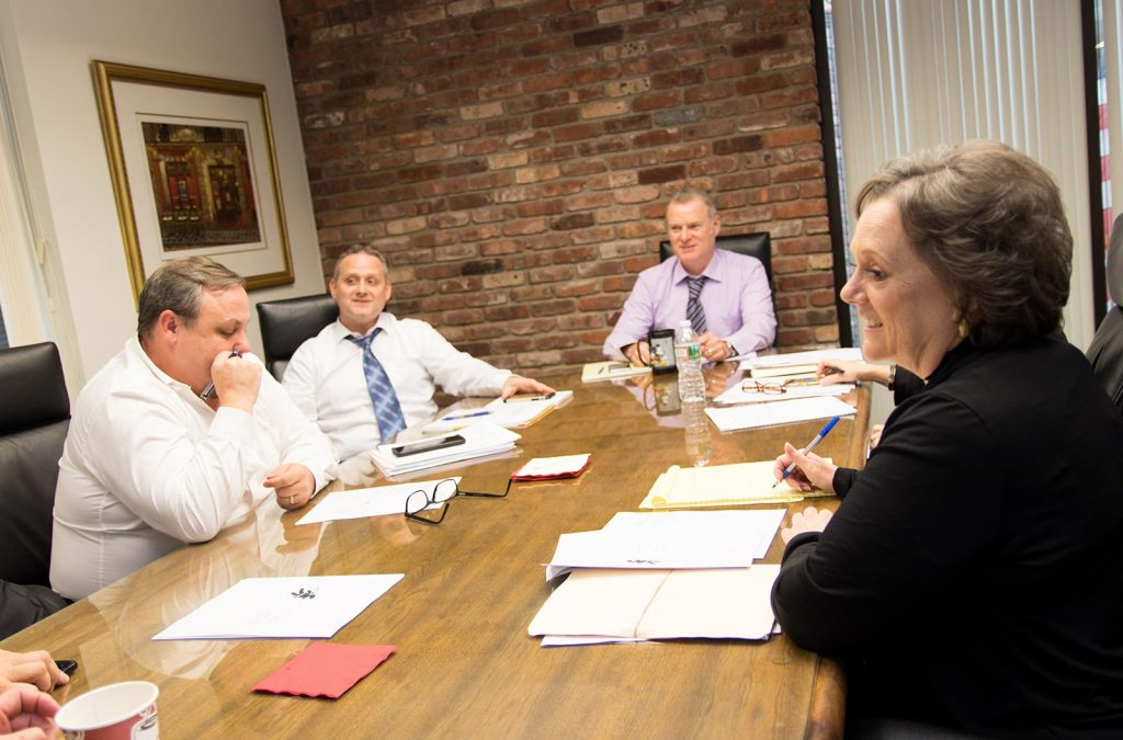 A team of people sitting around a conference table